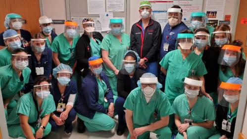 Group photo of healthcare workers wearing 3D-printed face shields