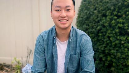 Photo of Eddy Yeung sitting on bench